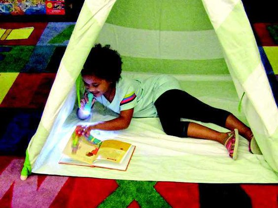 1 girl in tent reading