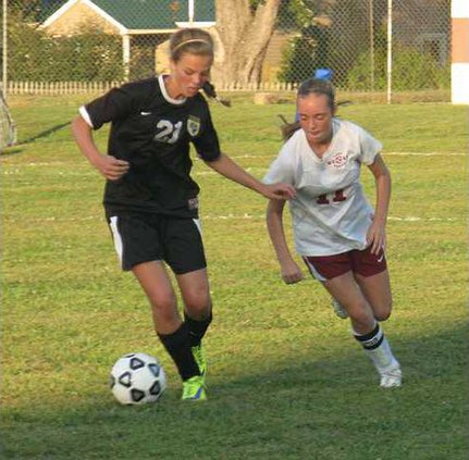 Taylor Spare  wins the ball against White Co