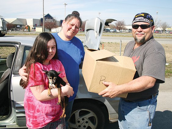 Melinda Austin with dog Radar, Lindy Elrod and Jay Austin with box.jpg
